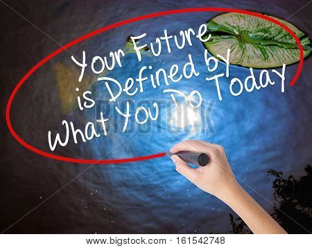 Woman Hand Writing Your Future Is Defined By What You Do Today With Marker Over Transparent Board