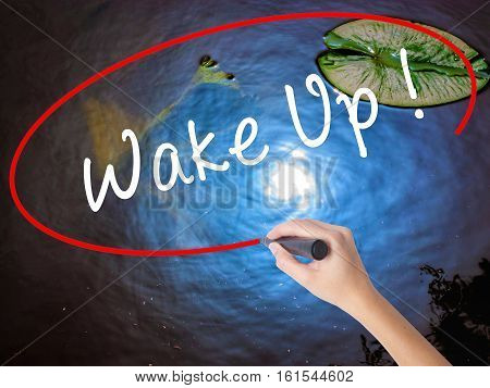 Woman Hand Writing Wake Up With Marker Over Transparent Board