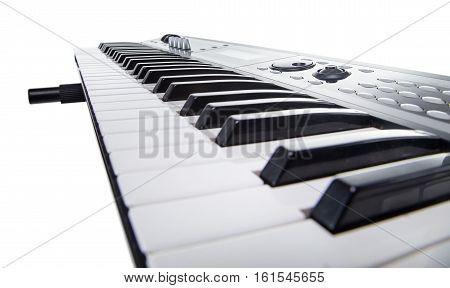 Isolated keyboard of synthesizer on white background