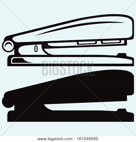 Metal stapler. Isolated on blue background. Vector silhouettes