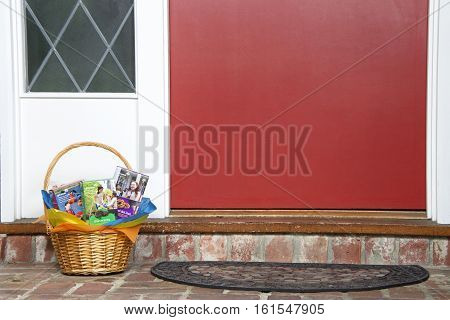 ALAMEDA CA - FEBRUARY 14 2016: Gift Basket with assortment of ABC Baker's brand Girl Scout cookie boxes home delivered red front door. Girl Scout cookies only available once a year.