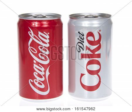 Alameda CA - March 28 2016: Coke and diet coke cans Isolated On White Background. Coca-Cola is a carbonated soft drink sold in stores restaurants and vending machines worldwide.