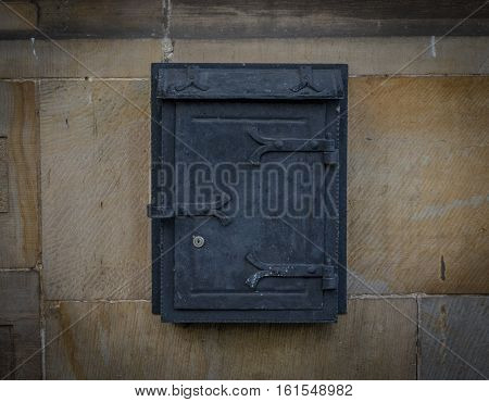 The Old, Iron Mailbox On A Stone Wall.