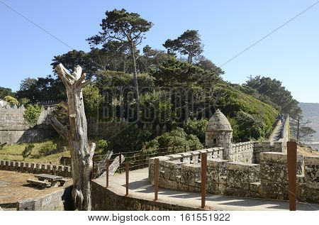 BAYONA, SPAIN - AUGUST 7, 2016: Path in the upper part of the walls of the Monterreal Castle in Ria of Vigo in Bayona Galicia Spain.