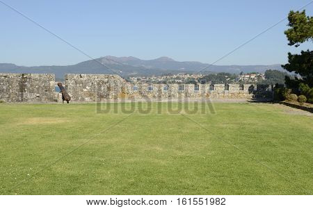 BAYONA, SPAIN - AUGUST 7, 2016: Cannon at the walls of the fortress in Monterreal Castle in Ria of Vigo in Bayona Galicia Spain.
