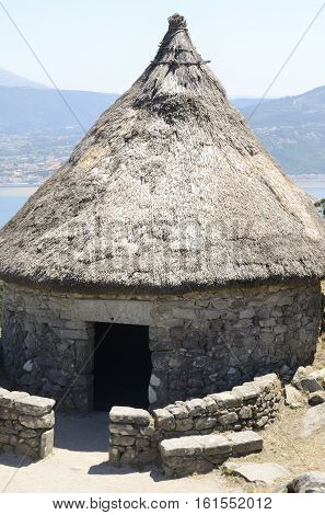 Reconstructed house in the remains of a celtic settlement in Santa Tecla Mount in Galicia Spain.
