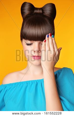 Makeup. Manicure. Hairstyle. Beautiful Teen Girl With Bow Hair Style And Multicolor Manicured Polish