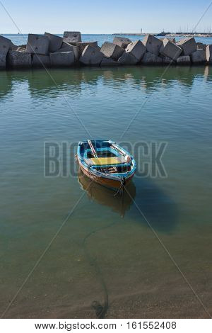 Boat moored in the port of Salerno in a sea green waters. Salerno destination for tourism and culture