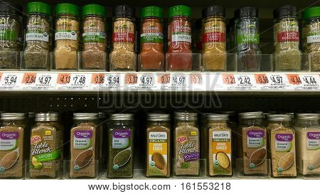 San Leandro CA - April 08 2016: Grocery Store shelf display with McCormick and Organic brand spices. Knowing how to use spices can greatly enhance the flavor of all your dishes.
