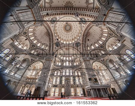 ISTANBUL, TURKEY - APRIL 13, 2015: Sultan Fatih Mosque: Interior Mosque of sultan Mehmed the Conqueror. The mosque was built in 1463-1470 destroyed by an earthquake in 1766 and rebuilt in 1771.