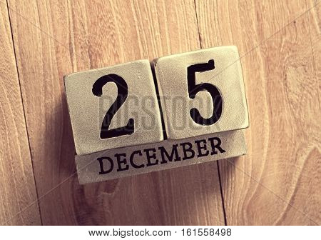 calendar set on the 25 of December on wooden background