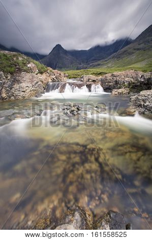 Waterfall in the Fairy Pools rocky stream on Isle of Skye