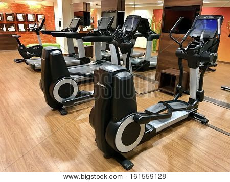 MUNICH - DECEMBER 14: Life Fitness Cross-trainer, Treadmill and Exercise Bike equipment at The Marriott Courtyard Hotel on December 14, 2016 in Munich, Germany.