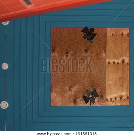 Abstract bright background of the wooden panels, sensors, and surveillance camers