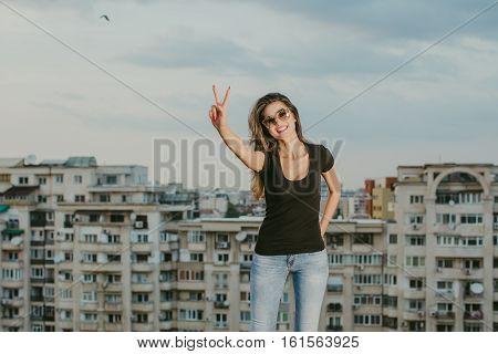 Beautiful portrait of a sexy woman, urban background