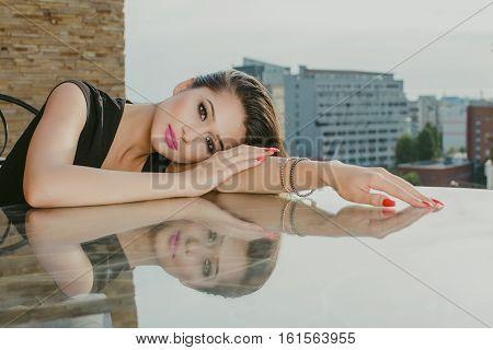 Beautiful portrait of a sexy woman on glass