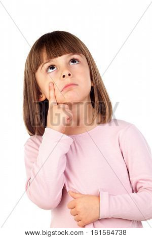 Pensive small girl with pink t-shirt isolated on a white background