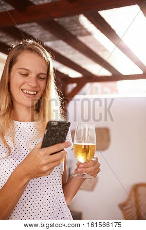 Happy Blond With Her Cell And Beer