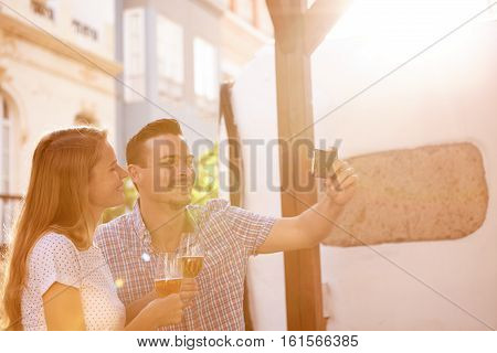 Defocused Smiling Couple Taking A Selfie