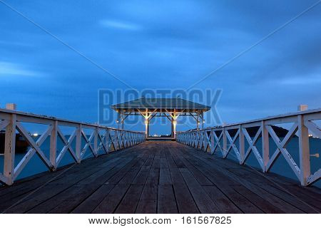 jetty walkway with pavilion in twilight time