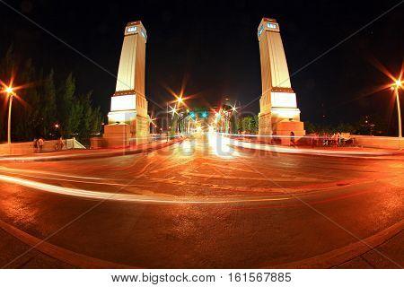 Light trail at rama 1 steel bridge at Bangkok harbor in fish eye perspective
