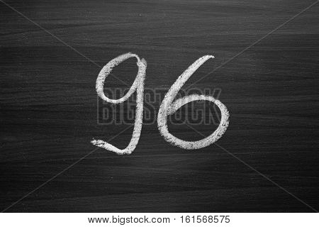 number ninety six enumeration written with a chalk on the blackboard