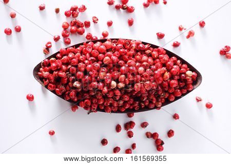 Red peppercorn or Brazil Pepper on oval container