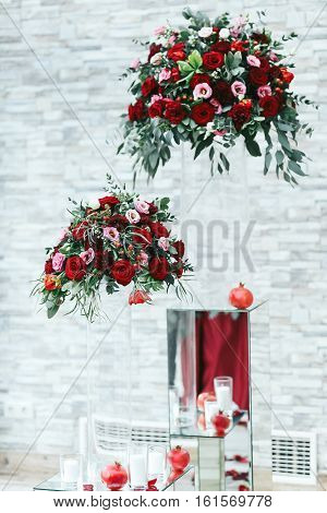 Glass Decor With Red Bouquet Of Roses And Greenery