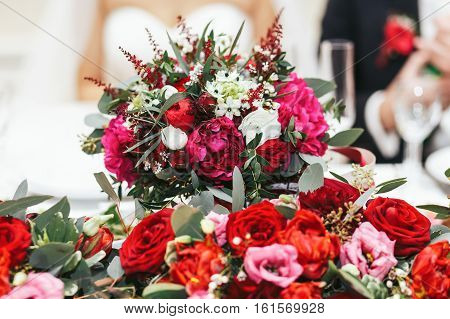 Flower Decoration Of The Newlyweds' Table In The Restaurant