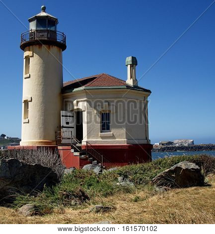 An old light house on the Coquille River at the bay in Bandon on Oregon's central coast on a sunny summer day.