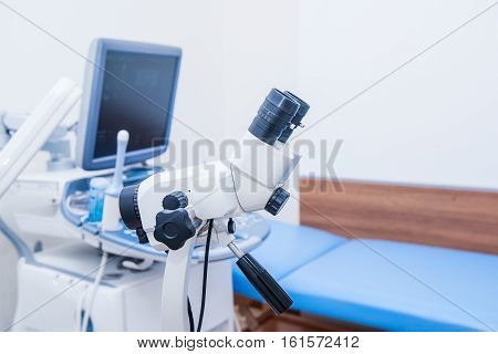Close up colposcope on the background of ultrasound machine in gynecological room