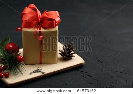 Christmas Gift Box, And Decorations On Dark Concrete Background