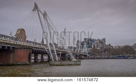 London UK - 12th December 2016: A view of the Golden Jubilee Bridge with Charing Cross Railway Staion in the background.