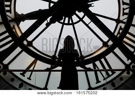 November 13, 2016 - Paris: Woman Silhouette Standing In Front Of Clock In The Orsay Museum, Paris, F