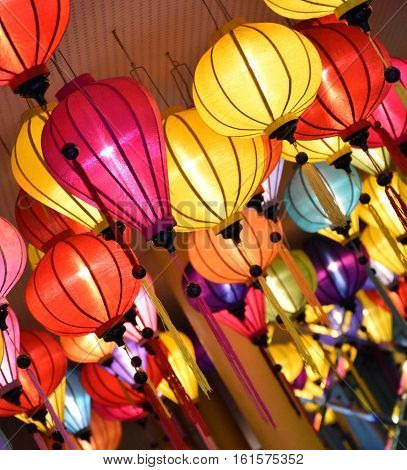 Colourful chinese lanterns hanging from a ceiling