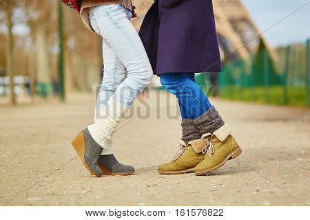 Closeup Of Female Legs, Two Girls Hugging On The Street In Paris