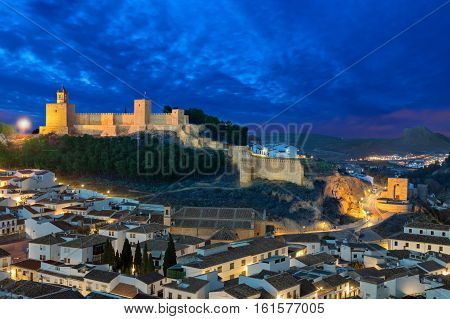 Illuminated moorish fortress Alcazaba in Antequera Andalusia Spain