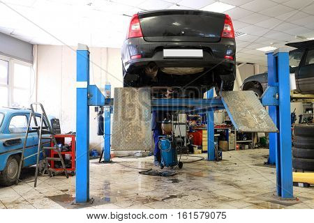 Car in a car repair station