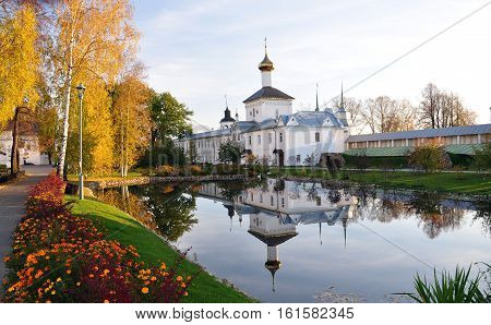 Beautiful Church reflected in a pond. Yellow trees in autumn