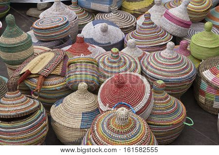 Asheville, North Carolina, USA - September 10, 2016: A variety of colorfully woven intricate and artistic African style baskets for sale at a Goombay festival on September 10, 2016 in downtown Asheville, NC