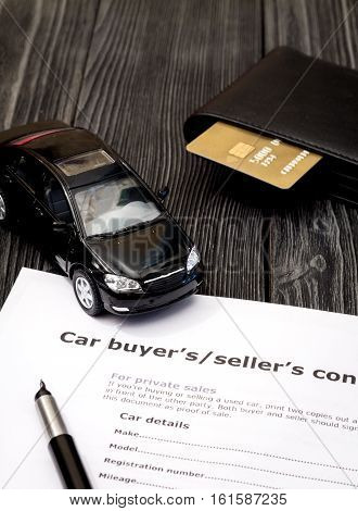 concept of buying car on dark wooden background close up