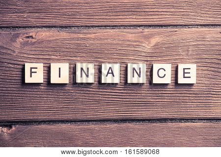 Business conceptual word finance collected from wooden elements with the letters