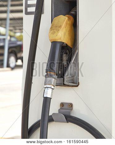 Yellow gas pump Fuel nozzle pump environment, petrol