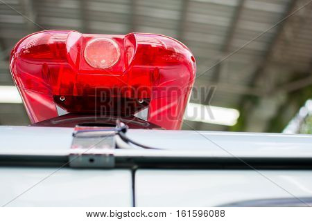 red flashing sirens of police car during the roadblock in the city