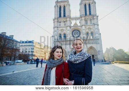 Two Young Girls Near Notre-dame In Paris