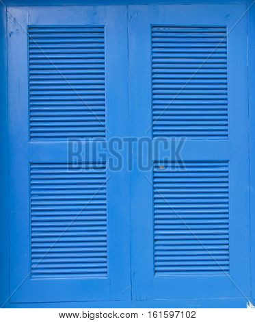 The blue wooden window frames in white