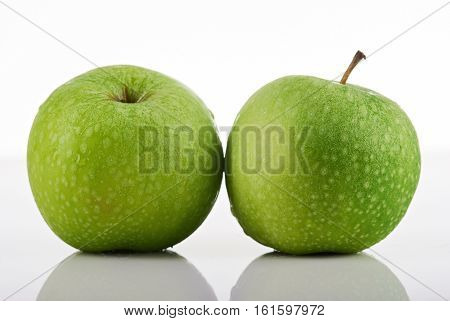 two green apples isolated on hite background