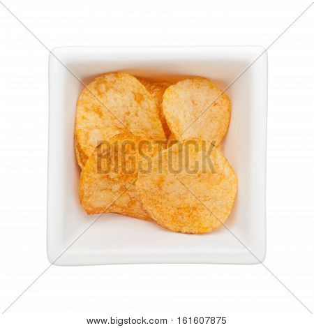 Pieces of potato chips in a square bowl isolated on white background