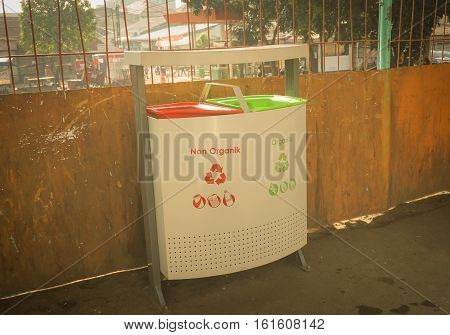 trash can or box with organic and non-organic on pondok cina station photo taken in jakarta indonesia