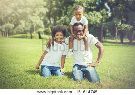 Happy And Cheerful African American Family Of Father, Son And Daughter